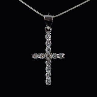 Tiny silver cross with zircons